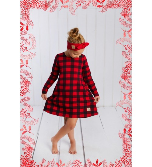 Tuss vaikiška suknelė. Spalva raudona su langeliais